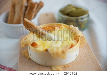 Baked Cheese - Melted cheese dip served with bread