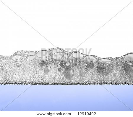 foam on water surface, section view