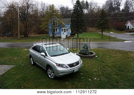 Lexus in Front of a Harbor Springs Home
