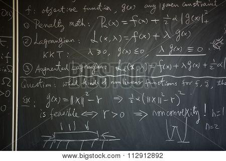 Blackboard with math lesson written on it