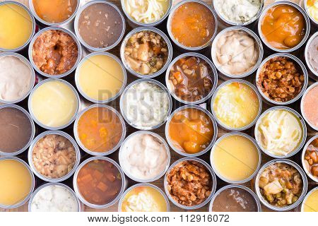 Colorful Background Of Opened Cans Of Soup