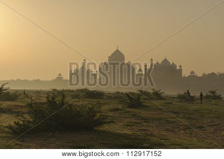 The foggy morning view of Taj Mahal with during sunrise from the Yamuna river Agra India.
