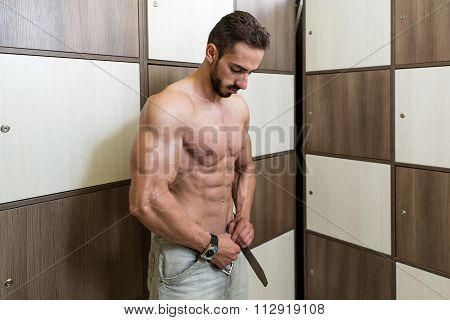 Athlete Changing Clothing In Gym Locker Room