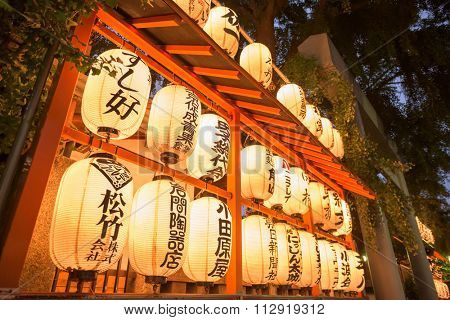 TOKYO, JAPAN - JULY 28, 2015: Namiyoko Inari Shrine lanterns near Tsukiji Fish Market. Created after the 1923 Great Kanto earthquake, the shrine is the unofficial guardian shrine for the marketplace.