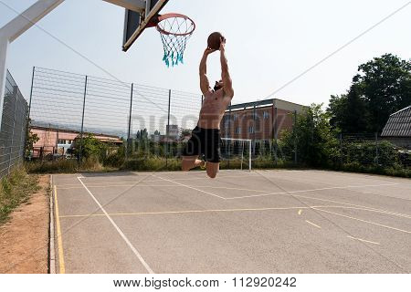 Basketball Player Is About To Slam Dunk