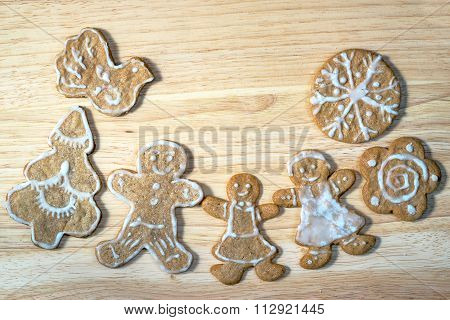 Happy Family Concept - Gingerbread Homemade Figures Of Mother, Father And Daughter Together Near Chr