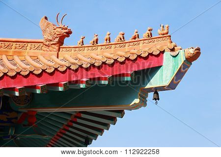 A traditional chinese temple in Thailand decorated with mythological beasts