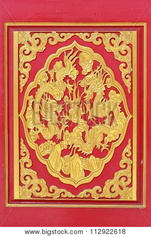 Golden Dragon Decorated On Wood Carved On Red Door, Chinese Style In Dragon Temple Kammalawat (wat L