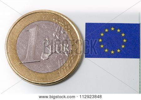 One Euro Coin And Eu Flag