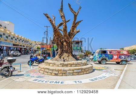 Famous tree, hippie bus and motorcycles  in Matala center on Crete island