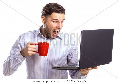 Handsome Surprised Businessman Holding Red Cup And Looking At La