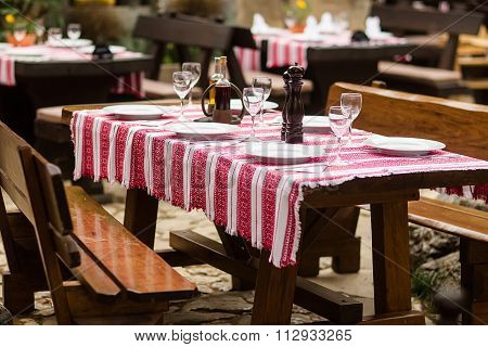 Table Set With Embroidered Tablecloth