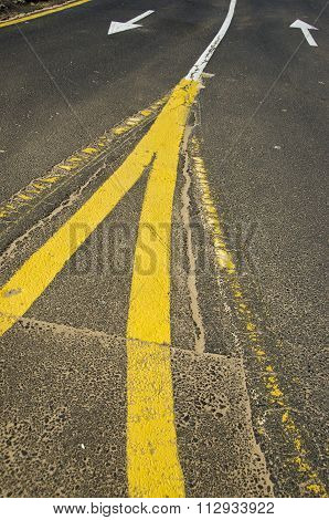 Yellow And White Lines On Asphalt
