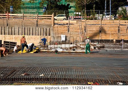 Workers Are Doing The Armoring At The Building Site To Stabilize The Fundament