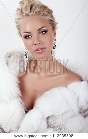 Sexy Woman With Long Blond Hair Wears Luxurios Fur Coat And Bijou