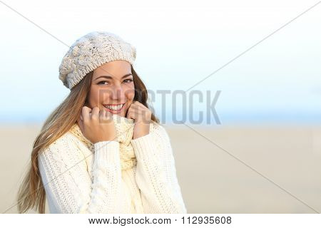 Woman Smiling Warmly Clothed In Winter