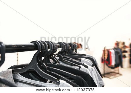White clothes hanging on hangers