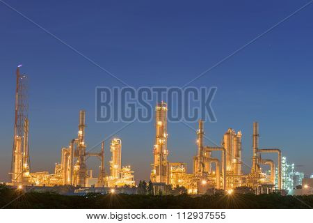 Twilight Of The Oil Refinery Plant And Blue Skies Background.