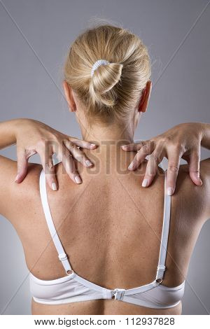 Woman With Pain In Shoulders. Pain In The Human Body