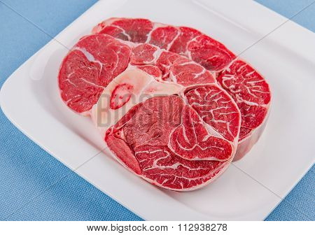 Two Fresh Veal Shank Meat On White Plate