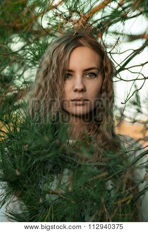 Portrait of a very beautiful girl in spruce