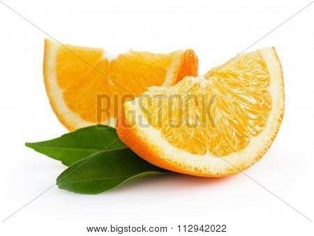 Two Slices Of Orange With Leaves