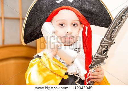 Little Girl Child Dressed As Pirate For Halloween. Kid In Carnival Costumes For Christmas