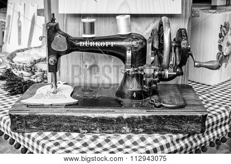 Manual Sewing Machine Used To Embroider Wooden Shapes.