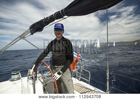 ANDROS - SYROS, GREECE - CIRCA APR, 2014: Sailors participate in sailing regatta 11th Ellada 2014 among Greek island group in the Aegean Sea, in Cyclades and Argo-Saronic Gulf.