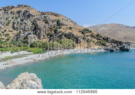 Tourists have a rest on the Preveli Beach