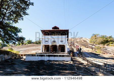 SHRAVANABELAGOLA, Karnataka/India - DECEMBER 20 2015: Pilgrims going to Gomateshwara temple