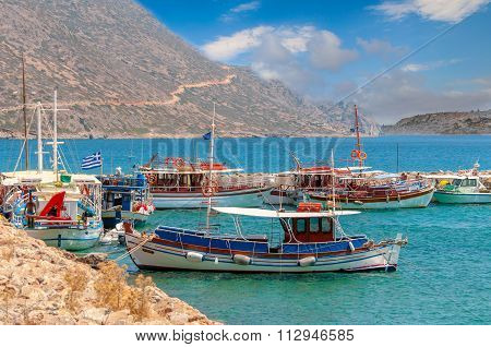 Traditional greek fishing boats in port near Aghios Nikolaos town on Crete island