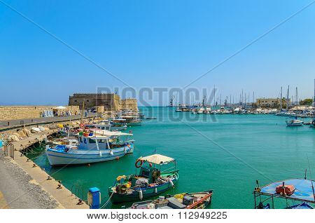 The traditional Greek fishing boats are located at Heraklion port