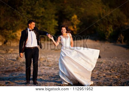Very Sensual And Gorgeus Wedding Couple On The Picturesque Landscapes On Sunset