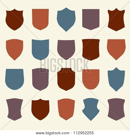 Shield icons set. Different colorful shield shapes in flat style. Vector illustration.