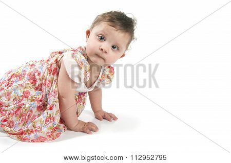 Baby Crawling On The Floor In A Beautiful Dress..
