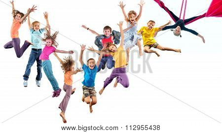 Group Of Happy Cheerful Sportive Children Jumping And Dancing