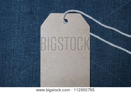 Price Tag Over Jeans Background