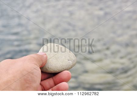 Hand With Stone