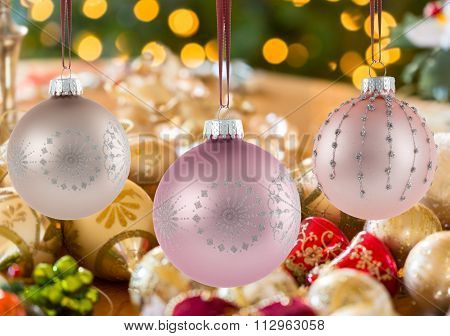 Three Christmas Decorations On Strings