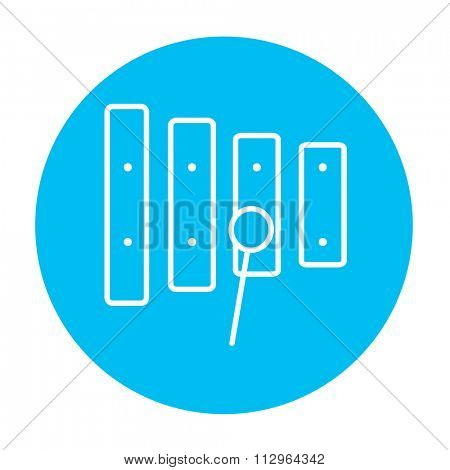 Xylophone with mallet line icon for web, mobile and infographics. Vector white icon on the light blue circle isolated on white background.