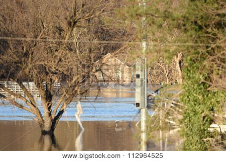 VALLEY PARK, MO/USA   JANUARY 1, 2016: Flood waters nearly submerge house in Valley Park in old town Fenton.