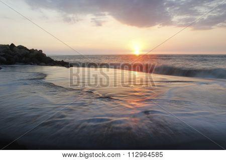 Beach Reflecting Sunset