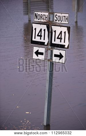 VALLEY PARK, MO/USA JANUARY 1, 2016: Highway 141 road sign submerged under flooding waters in Valley Park, Missouri