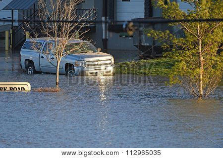 VALLEY PARK, MO/USA JANUARY 1, 2016: Flood waters near the Meramec River flood car and road sign in Valley Park, Missouri