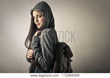 Girl carrying a rucksack