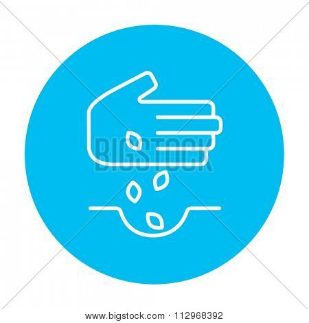 Hand planting seeds in the ground line icon for web, mobile and infographics. Vector white icon on the light blue circle isolated on white background.