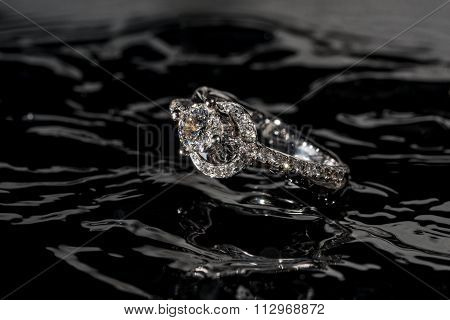 Diamond Engagement Ring Floating In The Water