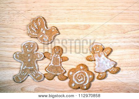Happy Family Concept - Gingerbread Homemade Figures Of Mother, Father And Daughter Together, With Bi