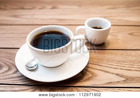 A cup hot americano coffee on wood table